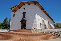 Historic old Spanish San Jose mission in Fremont under a bright blue California summer sky