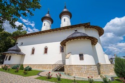 Historic orthodox church in Romania, church of Varatec Monastery in a summer sunny day.