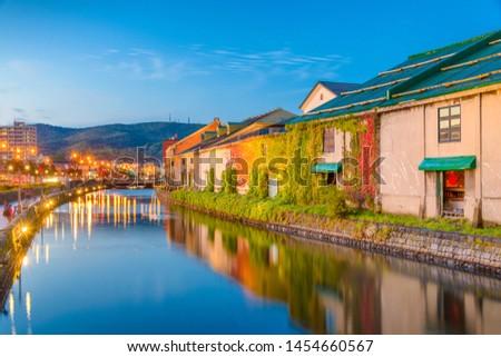 Historic Otaru Canals in Otaru, Hokkaido Prefecture, Japan at twilight.