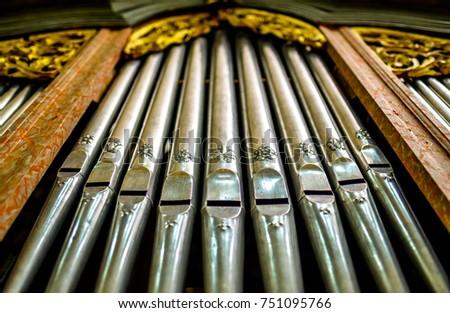 historic pipe organ at a church #751095766