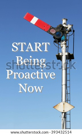 Historic red home British railway signal in the start position with an Inspirational motivational quote of Start Being Proactive Now against a clear blue sky