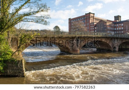 Historic river bridge and mill at Belper, Derbyshire, UK