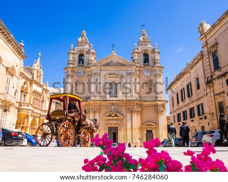 Historic Roman Catholic Cathedral of Saint Paul in main town square of Mdina village in  Malta, Europe Stock fotó ©
