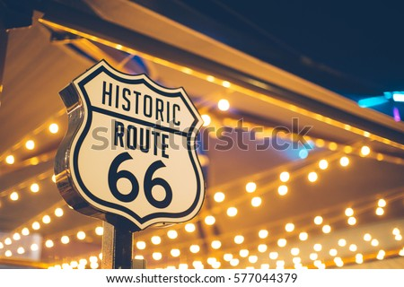Historic Route 66 sign in California with decoration lights on the background #577044379