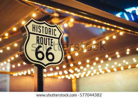 Historic Route 66 sign in California with decoration lights on the background #577044382