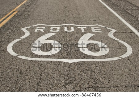 historic Route 66 sign on asphalt road  at national trails highway, California, USA