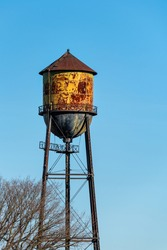 Historic Semiahmoo Water Tower, classic rusted round water tank on a sunny blue day