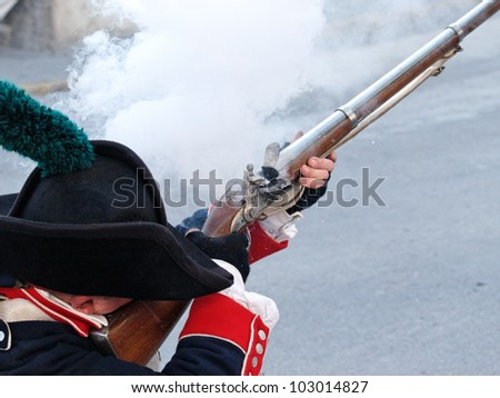 historic soldier shooting with an vintage gin, muzzle-loader, front loader