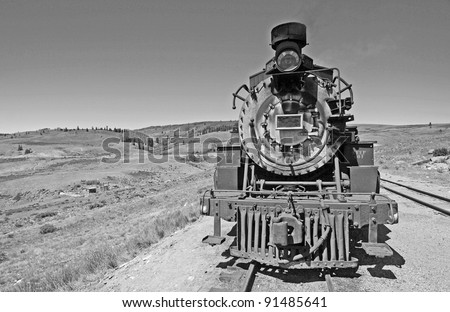 Historic Steam Engine crossing Rocky Mountains between Colorado and and New Mexico.  Converted to black and white from color original