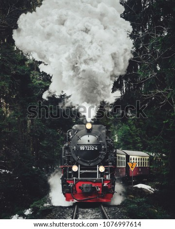 historic Steam locomotive, train in the snow in the mountains of Switzerland.