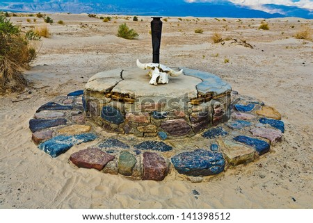 Historic Stovepipe Well and skull, Death Valley National Park, California