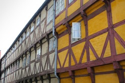 Historic timbered wooden buildings in the center of the city, Aalborg, Denmark, Europe.