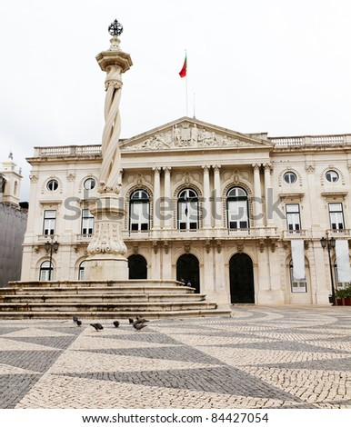 historic town hall of Lisboa capitol of Portugal with portuguese flag