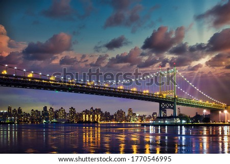 Historic Triborough Bridge from Astoria Queens towards New York City Manhattan after sunset with city lights Stock fotó ©