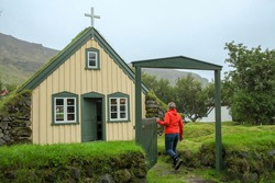 Historic turf Church Hofskirkja in the small icelandic village of Hof, Iceland. Hofskirkja Hof, Skaftafell. Charming mystical scene with turf roof church in old Iceland traditional style and mystical
