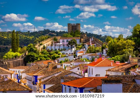 Historic walled town of Obidos, near Lisbon, Portugal. Beautiful streets of Obidos Medieval Town, Portugal. Street view of medieval fortress in Obidos. Portugal.