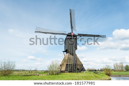 Historic windmill in the Netherlands with a paddlewheel. #181577981