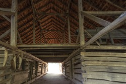 Historic wooden barn interior with hay loft in the Great Smoky Mountains National Park. This is a historical structure within a national park and not a privately owned property.