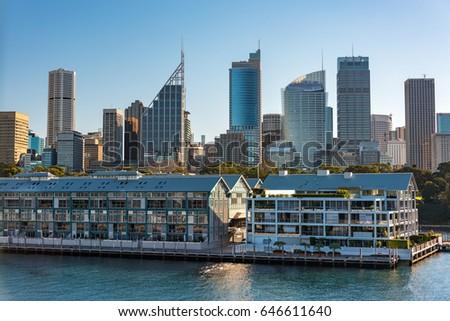 Historic Woolloomooloo wharf with Sydney CBD skyline skyscrapers on the background. Sydney cityscape on sunny day #646611640