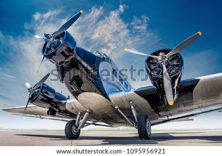 historical aircraft on an airfield Stockfoto ©