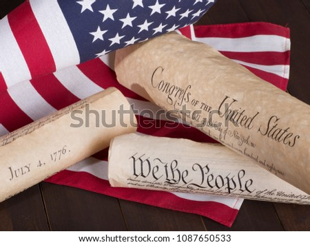 Historical American documents (Declaration of Independence, Constitution and Bill of Rights) with the United States flag