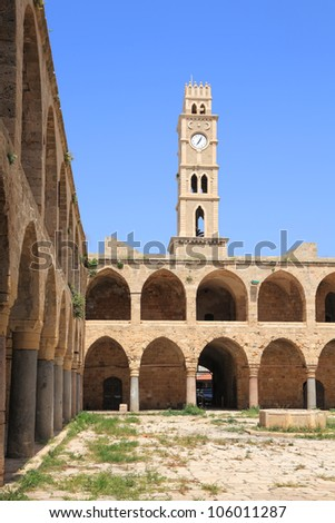 Historical ancient market square and clock tower in old city of Akko, the Mediterranean, Israel
