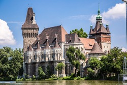 Historical building in Budapest - Vajdahunyad Castle with lake over the blue sky in main City Park. This is the similar castle like in Transilvania