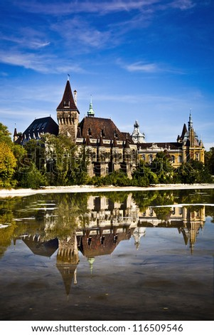 Historical building in Budapest - Vajdahunyad Castle with lake over the blue sky in main City Park. This is the similar castle like in Transilvania - stock photo
