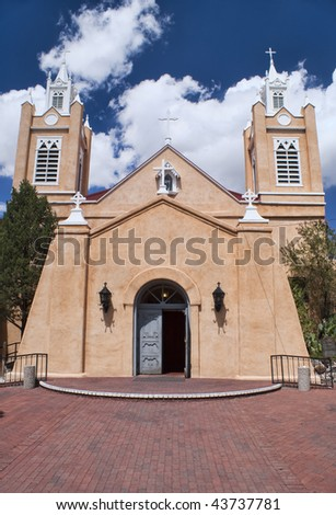 Historical Church of San Felipe with Blue Sky and White Clouds in background.  Old Town Albuquerque, New Mexico, USA. - stock photo