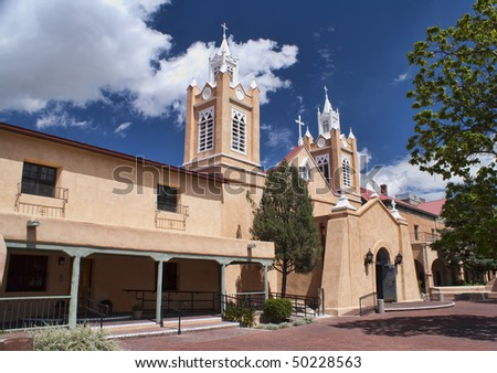 Historical Church of San Felipe with Blue Sky and White Clouds in background.  Old Town Albuquerque, New Mexico, USA.