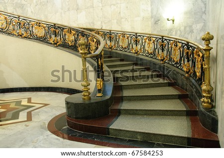 Historical entrance hall with vintage staircase / Spiral staircase