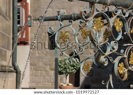 historical fountain details ornaments and objects in schwaebisch gmuend south germany city on a sunny summer day #1019972527