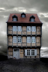historical German house with X-mas lights on a gloomy evening