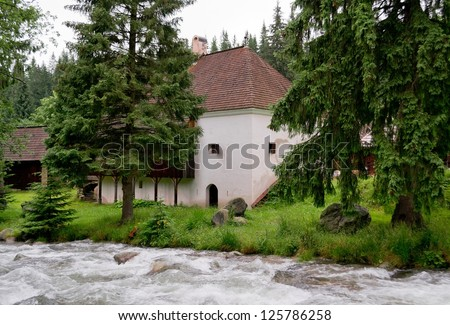 Historical house in nature with a forest and a river in Slovakia