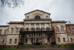 historical landmark old abandoned mansion, the manor of a rich man, abandoned people collapsing dilapidated building, a cultural monument without care and repair