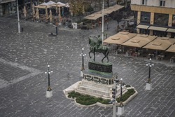 Historical monument in downtown Belgrade in heavy rain conditions