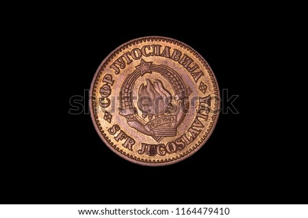 Historical numismatics coin 1943 dinar from Yugoslavia with coat of arms isolated on the black background