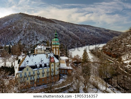 Historical palace in Lillafured, Miskolc on a snowy winter night. Castle building slightly covered with snow Stock fotó ©