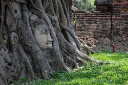 Historical Park A historical park in Ayutthaya, old city of Thailand  The old Buddha statue