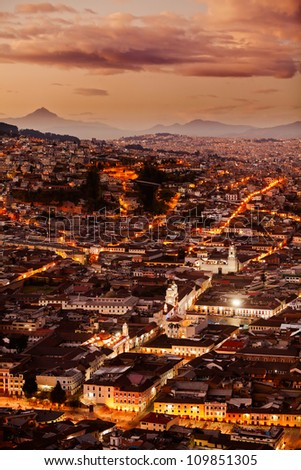 HISTORICAL PART OF QUITO, CAPITAL OF ECUADOR AS SEEN FROM PANECILLO STATUE AT DUSK OVERWORKED IN POST PROCESSING FOR BETTER VISUAL IMPACT