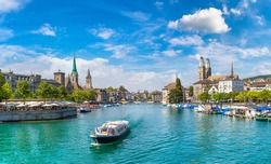 Historical part of Zurich with famous Fraumunster and Grossmunster churches in a beautiful summer day, Switzerland