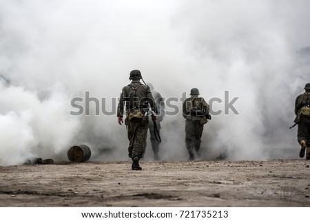 Historical reconstruction of the battle at Arnhem, German soldiers in a cloud of smoke. - Shutterstock ID 721735213