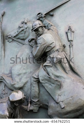Historical relief - Brutal killing and violence - aggression and aggressive attack of dominant warrior with sword. Defenceless person as victim during battle and fight