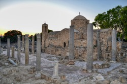 Historical ruins and columns of earlz Byzantine Chrysopolitissa church (Agia Kyriaki Chrysopolitissa) in Kato Paphos. Southern Cyprus. St Kyriaki. Ruins and blue sky. View of the ruins at sunset.