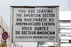 Historical sign at the former Checkpoint Charlie border crossing in Berlin, German