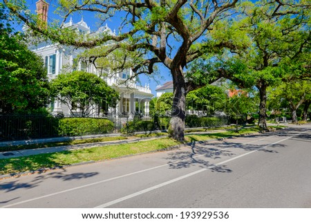 Historical southern style homes along Saint Charles Avenue in New Orleans, Louisiana. - stock photo