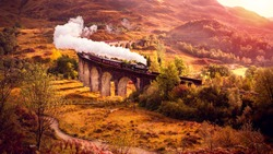 Historical Steam Train is crossing the Glenfiann Viaduct
