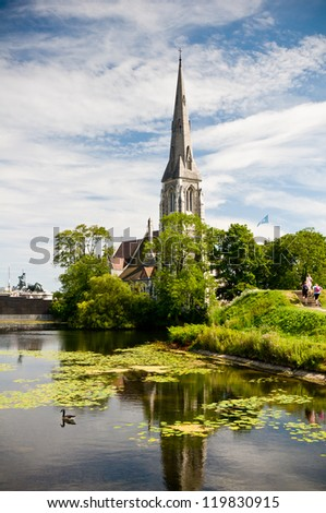 historical stone church by the lake - stock photo
