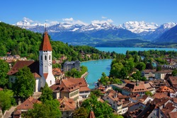 Historical Thun city and lake Thun with snow covered Bernese Highlands swiss Alps mountains in background, Canton Bern, Switzerland
