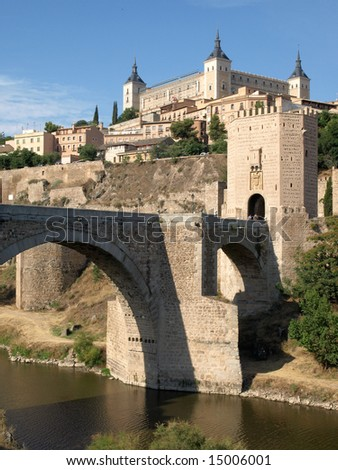 Historical Toledo view, bridge over Tagus and Alcazar fortified palace, Spain